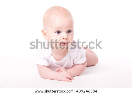 newborn baby in a white dress on a white background