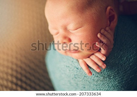 Newborn Baby in cocoon - close portrait of child