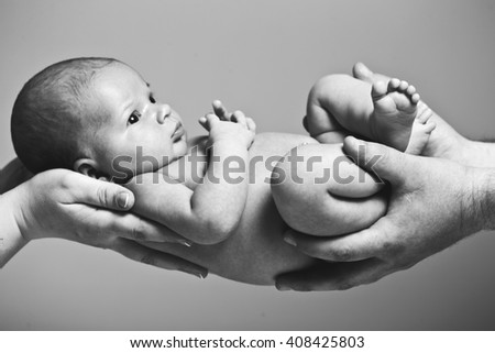 Newborn baby in  hand. black and white photography