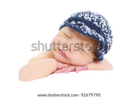 Newborn baby, infant,  sleeping on white background in a hat