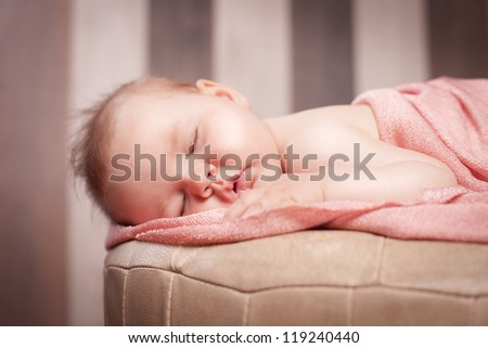 Newborn baby is sleeping - stock photo