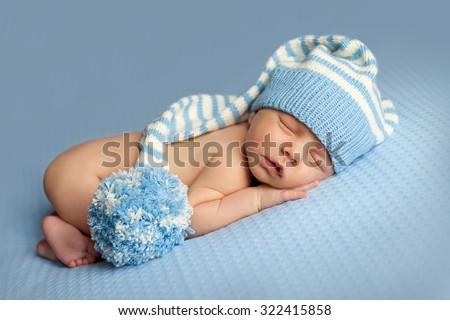 Newborn baby is sleeping - stock photo