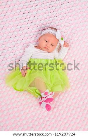Newborn baby laying on pink blanket - stock photo