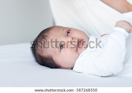 Newborn baby lies, and looking around.
