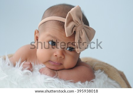 Newborn baby looking at camera, soft focus, shallow DOF