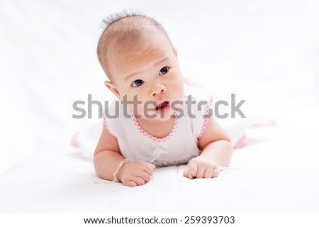 Newborn baby lying in bed, soft focus