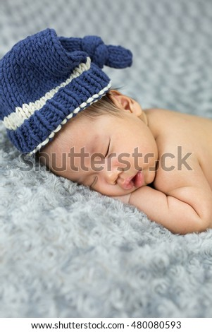 newborn baby on fabric gray,6 week old.