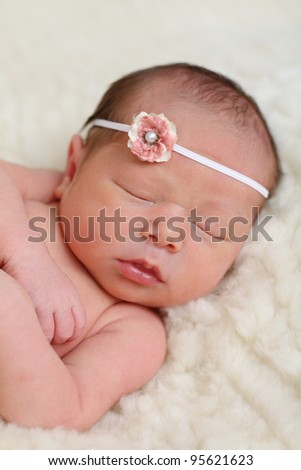 Newborn baby on sheep's wool - stock photo