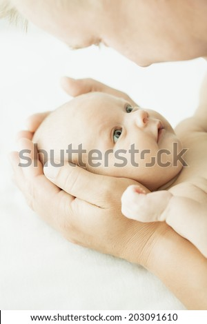 newborn baby one month age in the hands of his father  - stock photo