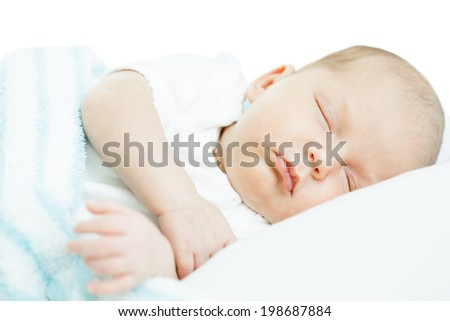 newborn baby one month age on white