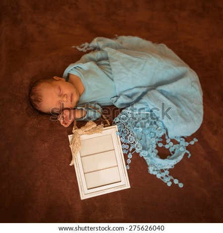 Newborn baby peacefully resting / photo from a newcomer little baby - stock photo
