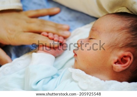 Newborn baby several days old enjoying new life