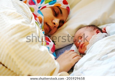 Newborn baby several days old enjoying new life - stock photo