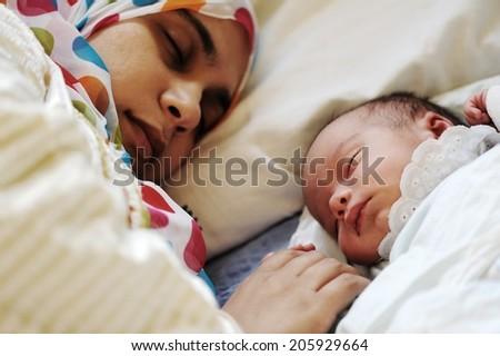 Newborn baby several days old enjoying new life - stock photo