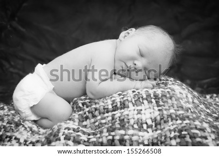 Newborn baby sleeping on  the blanket - stock photo