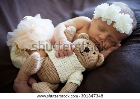 Newborn baby sleeping on white blanket - stock photo