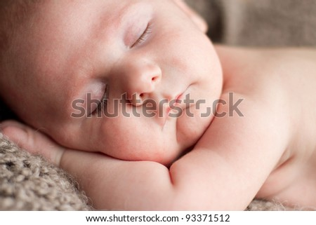 Newborn baby 6 weeks old peacefully sleeping