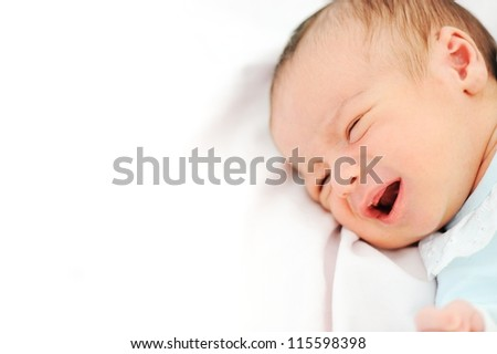 Newborn baby with copy space on the pillow