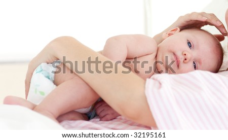 Newborn baby with his mother in hospital - stock photo