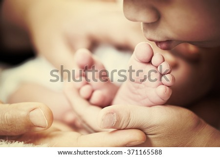 Newborn baby with his older brother - stock photo