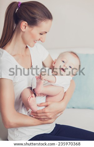 Newborn baby with his young mother