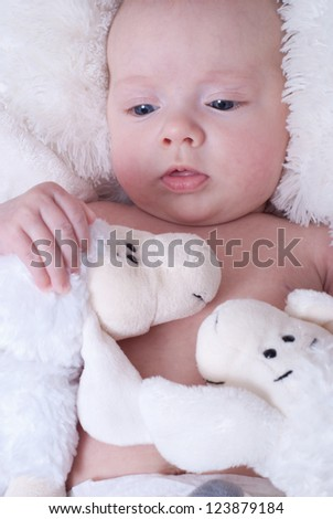 Newborn baby  with toys - stock photo