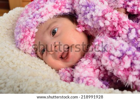 newborn close up lying on a soft bed. - stock photo