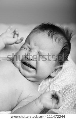 Newborn crying baby. Black-white image