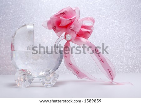 Newborn crystal stroller with ribbon bow - stock photo
