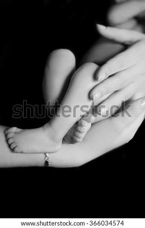Newborn girl and her mother - stock photo