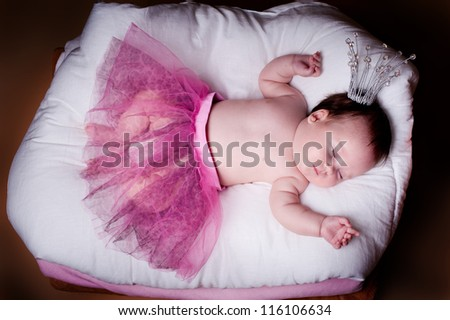 newborn girl in a princess costume. sleeps.