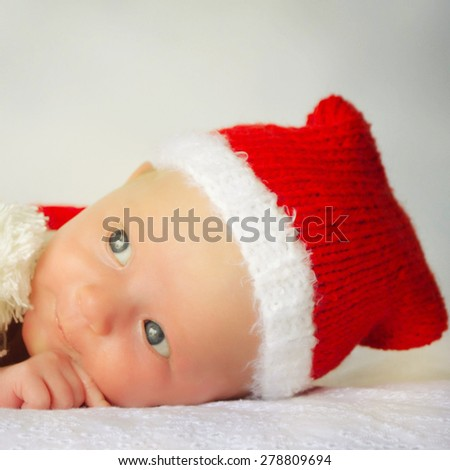 newborn girl in santa hat