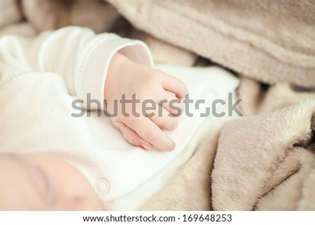 newborn hand close up