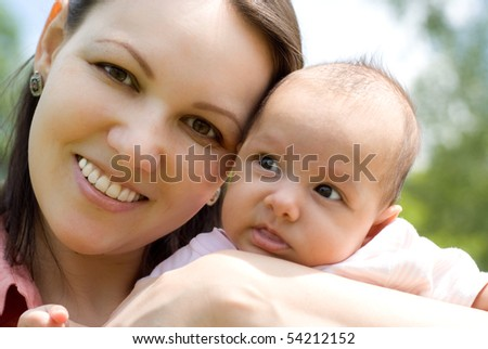 newborn in the arms of mother nature on the background