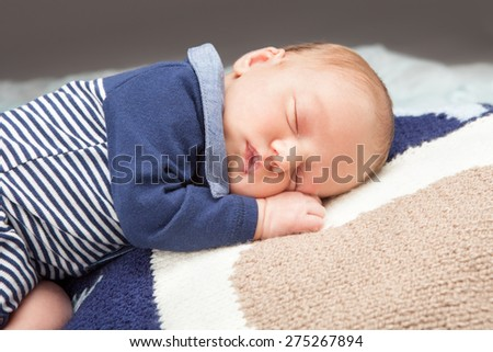 Newborn infant baby sleeping - stock photo