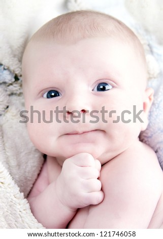 newborn infant in the arms of mom - stock photo