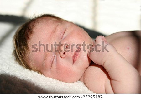 newborn infant laying in the sun - stock photo