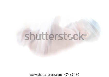 Newborn is wrapped in a covering of net and hangs suspended in a white background.  Could be represent battle over abortion, mother's choice, danger to babies or unborn. - stock photo