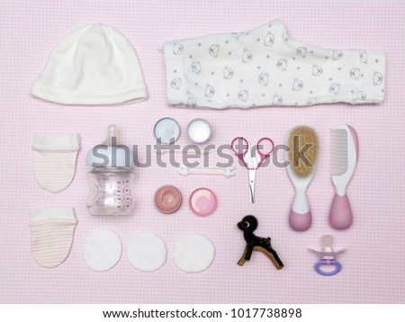 Newborn items on the pink background, knolling style. Top view. Flat lay.