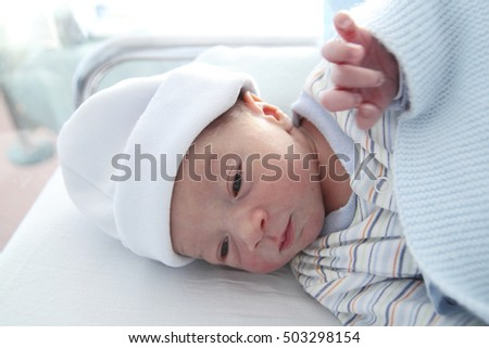 newborn one day old awake in the hospital