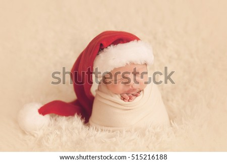 Newborn santa. Little boy sleep in santa hat