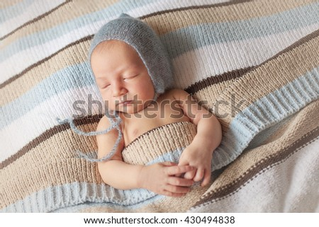 Newborn sleeping baby boy two weeks old, newborn posing