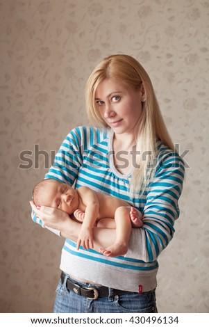 Newborn sleeping baby boy two weeks old, newborn posing - stock photo