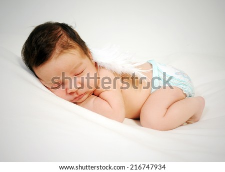 newborn sleeping baby with angel's wings portrait