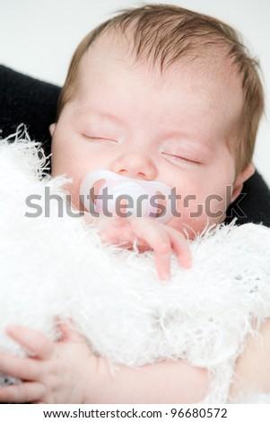 Newborn sleeping child - stock photo