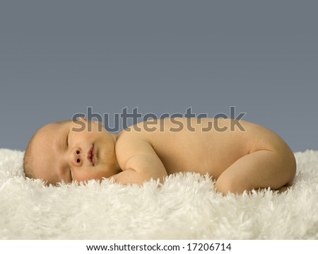 Newborn Sleeping on Fur