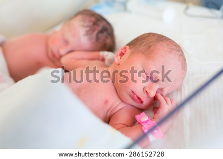 Newborn twins in the hospital after c-section - stock photo
