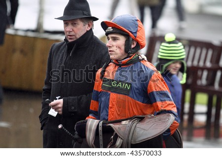 NEWBURY, BERKS - DEC 29: Jockey Harry Skelton discusses the third race with his father Nick Skelton as he returns from riding at Newbury Racecourse December 29, 2009 in Newbury, Berks