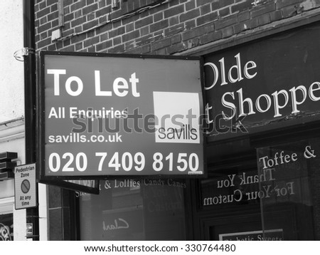Newbury, High Street, Berkshire, England - August 21, 2015: Commercial to let sign over vacant shop unit