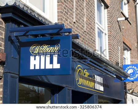 Newbury, Market Place, Berkshire, England - October 10, 2015: William Hill bookmakers, company founded by William Hill in 1934 at a time when gambling was illegal in Britain - stock photo